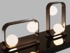 Infinity Light, Bronze Shadow bedside table lamps.